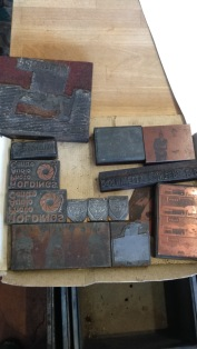 selection of vintage etched printing blocks from Blackburn shops, businesses, weddings and schools