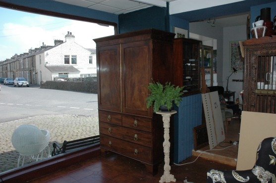 Lovely piece of antique furniture - the shelves are missing and clothes rail has been added. £450