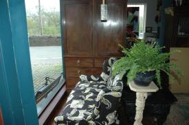 George III linen press cupboard alongside Gillows sofa