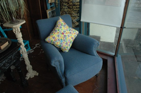 Lovely fully refurbished chair - blue heather tweed - reupholstered professionally. Coil sprung seat and back - great quality - with footstool